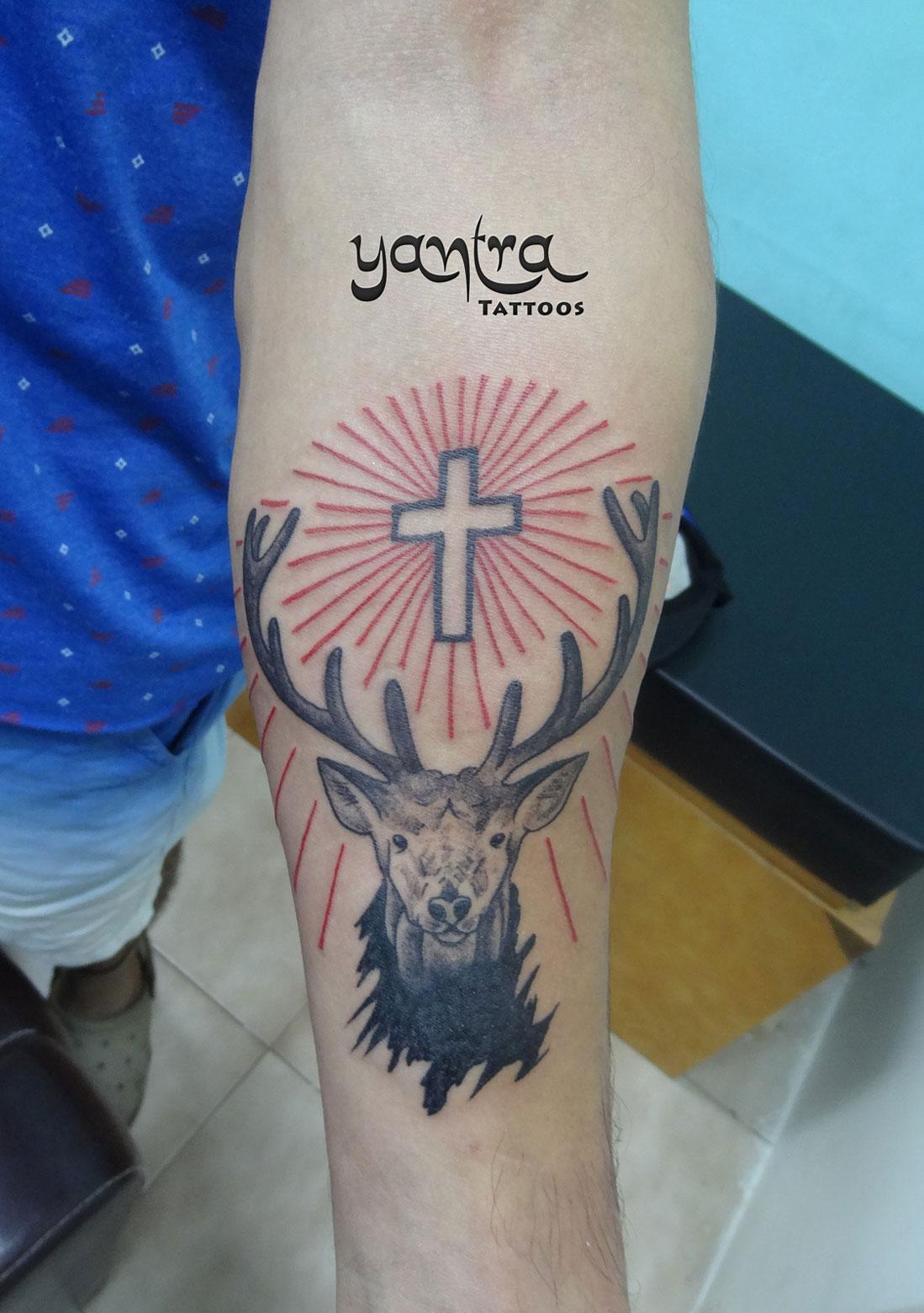 Jägermeister logo cross deer stag yantra tattoos chennai