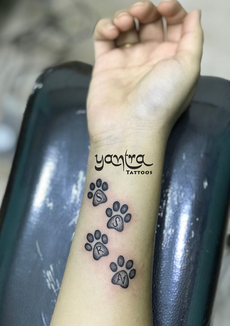 dog paws with initial tattoo