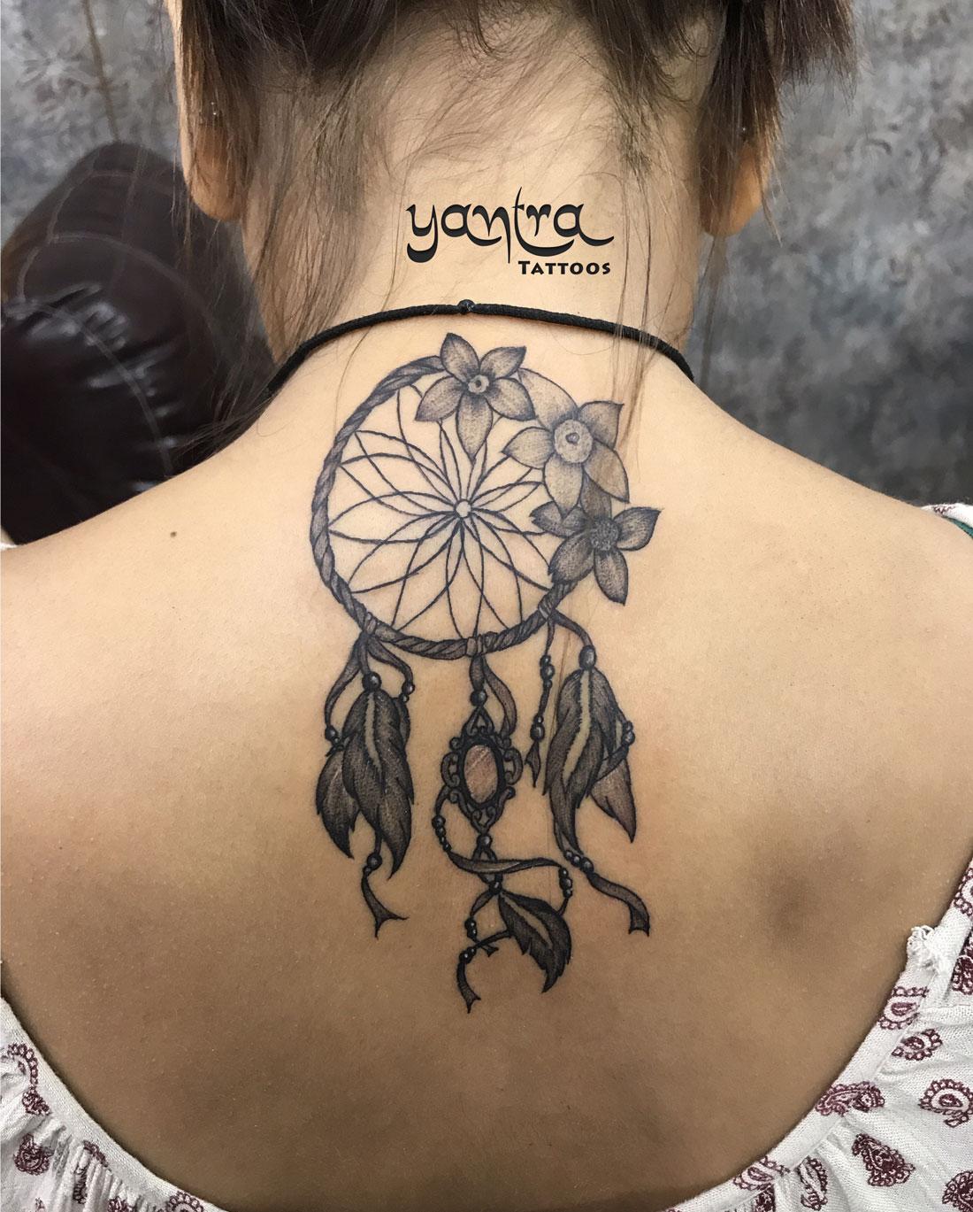 dreamcatcher tattoo with flower